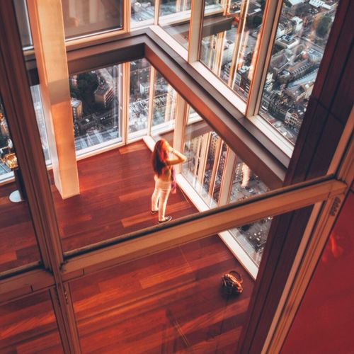 Elevated view of woman looking through window