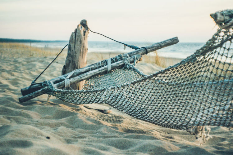 Sunny side up! 🌞 Beach Beachphotography Day Fishing Industry Fishing Net Focus On Foreground Hammock Land Nature No People Old Outdoors Rope Sand Scenics - Nature Sea Sky Springtime Sunset Swing Tranquil Scene Tranquility Transportation Water Wood - Material