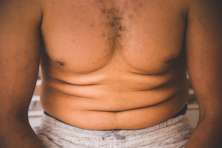 close up of men fat belly Beer Body & Fitness Diet Stomach Adult Alcohol Bad Habit Belly Body Part Dieting Fat Front View Hairy  Hairychest  Health Indoors  Lifestyles Men Midsection People Real People Shirtless Sport Unhealthy Eating Unhealthy Lifestyle