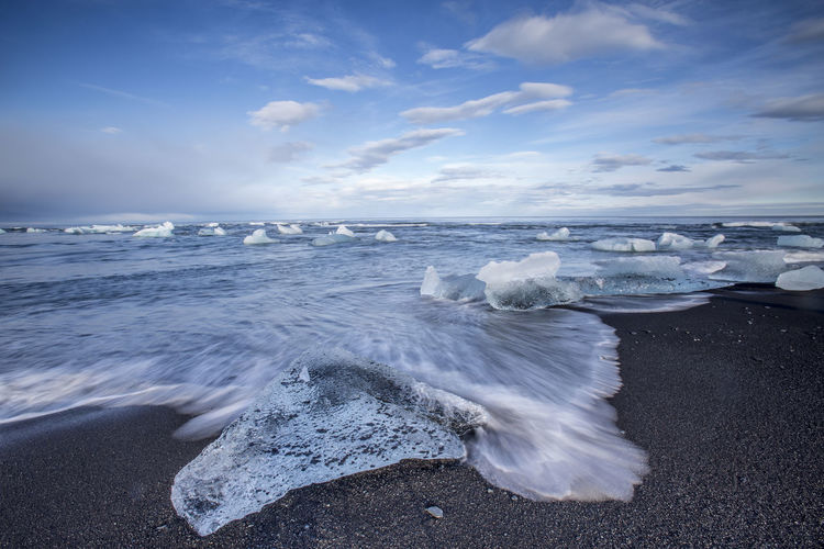 Iceland Beach Beauty In Nature Blue Cloud - Sky Cold Temperature Day Diamond Beach Horizon Over Water Ice Beach Iceberg Motion Nature No People Outdoors Sand Scenics Sea Sky Tranquil Scene Tranquility Water Wave