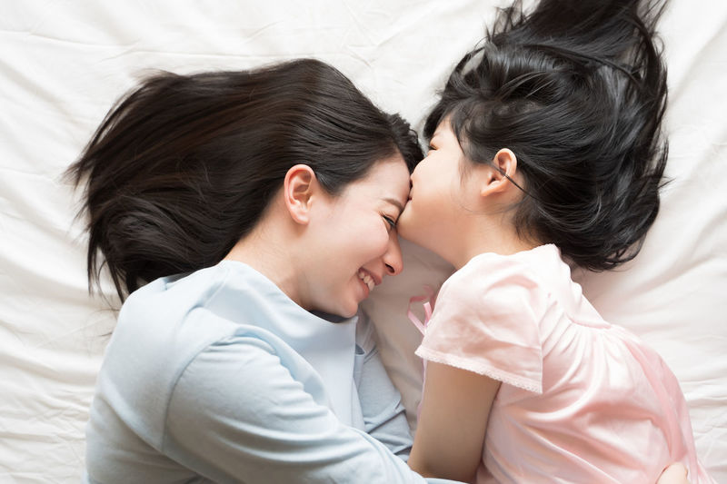 Daughter kisses her mother's forehead. and hugging in the bedroom .Happy Asian family Asian  Asian Girl Women Hapy Thai Ethnicity Japanese  Korean Taiwanese Smiling Family Love Daughter Mom Happiness Mother Girl Girls ASIA Bedroom Kissing Kiss Bed Two People Real People Togetherness Furniture Bonding Positive Emotion Lifestyles Emotion Indoors  Lying Down Headshot Adult Relaxation People High Angle View Young Women Couple - Relationship
