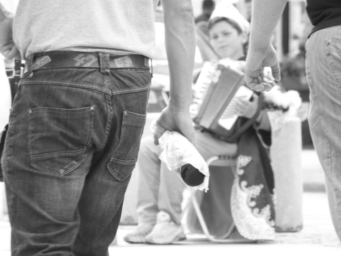 Accordion playing street kid in his princes outfit. He was playing his accordion in the blistering heat, as people walked by. 47 Arse Black & White Black And White Casual Clothing Jeans Lifestyles Poland Prince  Real People Rear Street Musician Warsaw Warsaw Poland Young Men The Tourist The Street Photographer - 2016 EyeEm Awards Outdoors Photojournalism