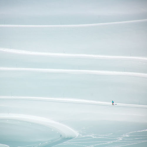 Aerial view of person snowboarding on snow