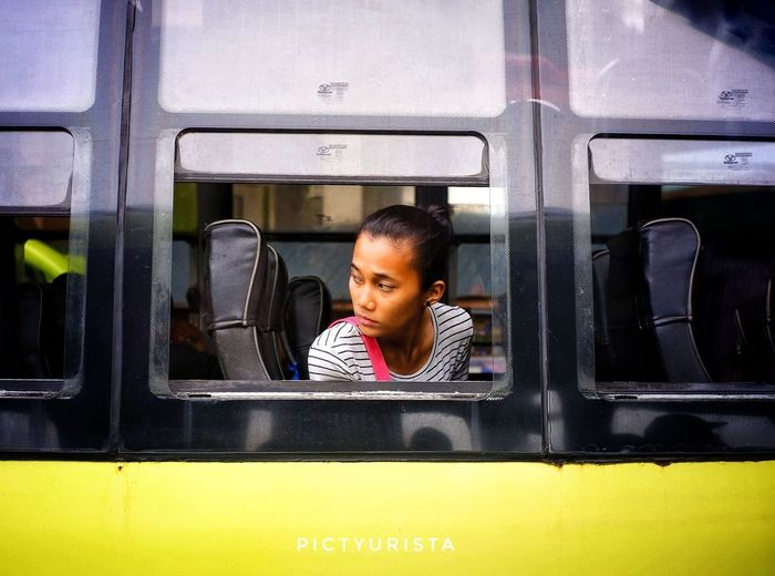 """Silip"" On my way to Davao City, this picture was taken at Tagum Bus terminal, a lady peeping through the bus window. I just take the snap, and want to try and practice framing. :) Fujifilm XT100 7artisans Randomphotos Composition Fuji Hobbyistphotographer Ndfiltered Philippines Photographer Landscapephotography Lensculture Streetphotographyworldwide Newbie Street_focus_on Streets_storytelling Streetphotographycommunit Streetphotography Streetsleaks Streetclassics Young Women Human Face Human Hand Looking Through Window Females Beautiful Woman Window Business"