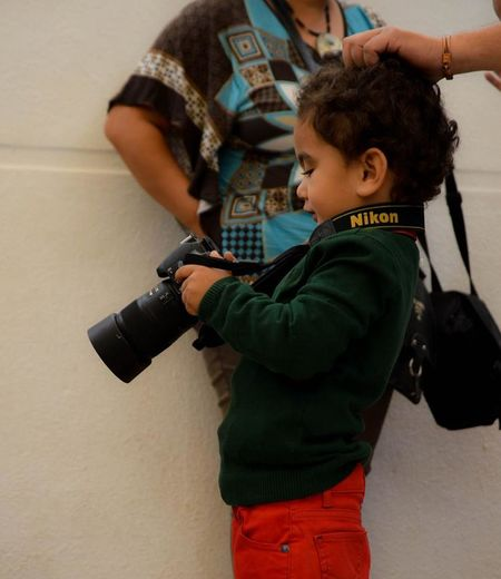 Youngest Nikon Photographer of the decade! <3 Boys Child Childhood Close-up Day French Boy Holding Indoors  Leisure Activity Lifestyles Males  Maternelle Nikon People School Party Standing Super Two People École