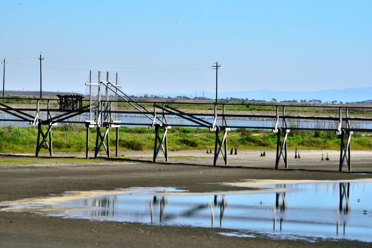 Eden Landing at Lowtide 1 Tidal Wetlands Wildlife Refuge Eden Landing Ecological Reserve Marsh Marshlands Salt Pond Lowtide  Mudflats Catwalk Gate Reflection Reflections In The Water Silhouettes Marin Headlands Telephone Poles & Lines Pier Landscape_Collection Bay Trail Levees Waterfowl Water Rural Scene Sky Landscape Reed - Grass Family Wetland Barbed Wire