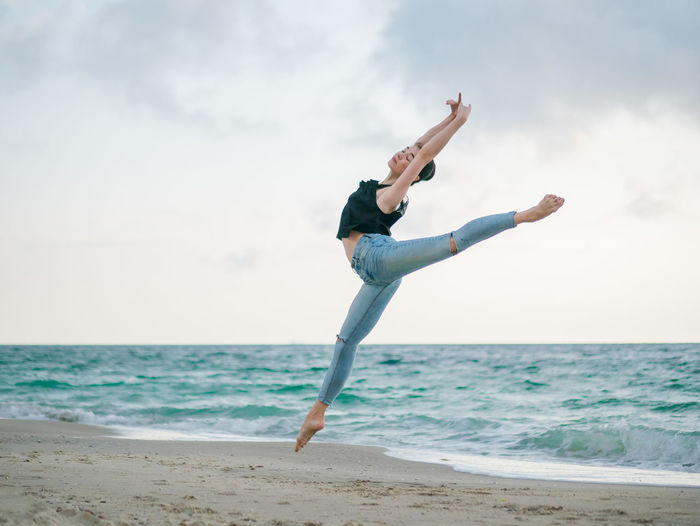 Ballerina Elegance Everywhere Jump Nature Pointe Shoes Woman Ballet Beach Beauty In Nature Dancer Day Flexibility Girl Legs Ocean One Person Professional Sport Real People Sea Silhoette Stretching Summer Tender Tutu Water