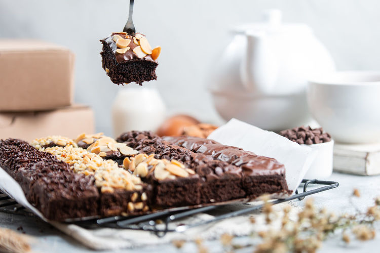 Close-up of chocolate cake on table, a homemade brownies slice with various topping