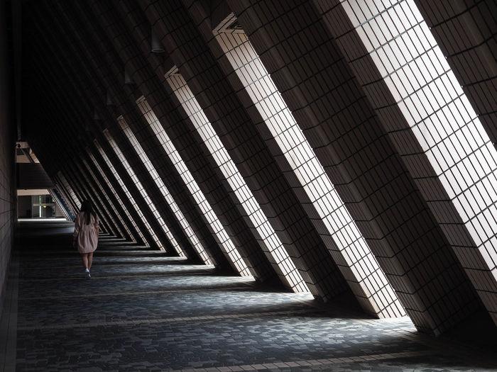 Woman walking in building