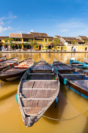 Boats tied on the dock along the riverbank of the Thu Bon River in the Old Quarter of Hoi An (Hội An), Vietnam. Hoi An is a popular tourist destination in central Vietnam. Hoi An Hoi An Streets Hoi An Vietnam Vietnam Vietnam Trip Travel Photography Central Vietnam Hoi An Boat Animal Themes Hoi An Old Town Hoi An Ancient Town