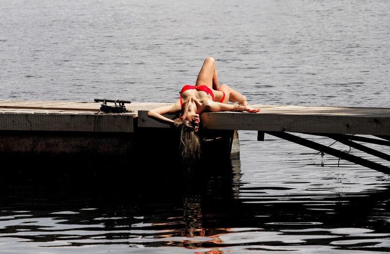 Woman sitting on boat in lake