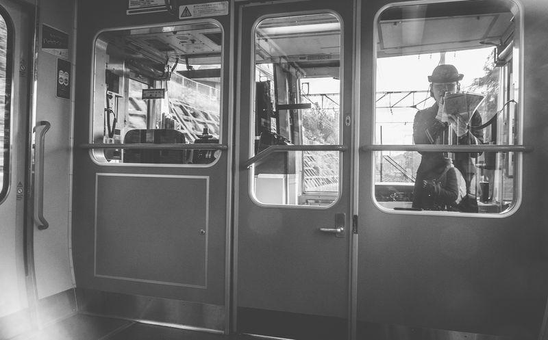 Black And White Day Japan Japan Photography Land Vehicle Mode Of Transport Passenger Train People Public Transportation Rail Transportation Real People Train - Vehicle Transportation Window
