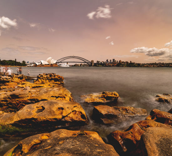 The dust storm this morning turned the sky orange-purple and made the clouds popping out like.. 😳😜 Water Built Structure Arch Bridge Bay Cityscape City Nature Rock - Object Rock Travel Destinations Bridge - Man Made Structure Sky Bridge Sydney Australia Sydney Harbour  Sydney Harbour Bridge Sydney Opera House Dust Dust Storm Red Sky Orange Sky Purple Wide Angle Haze