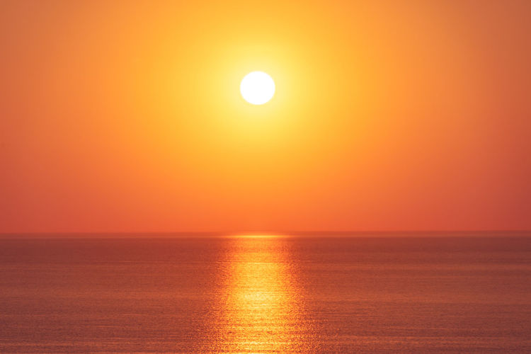Beauty In Nature Bright Dramatic Sky Horizon Horizon Over Water Idyllic Nature No People Orange Color Outdoors Reflection Romantic Sky Scenics - Nature Sea Sky Sun Sunlight Sunset Tranquil Scene Tranquility Water Waterfront