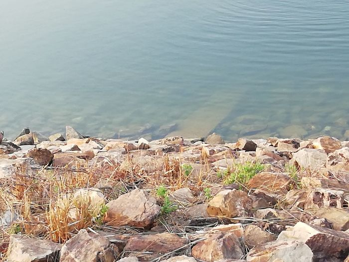 Clear water lake with awesome rock Bank of lake River Bank  Ponds Pond Bank River Lake Lake View Lake Bank Calm Water Clean Water Clear Water Lake Clear Water Yellowish Rock Rock Twin Color Inside Water Water Full Frame Stack Close-up Shore Lakeshore Pebble Beach Calm Standing Water Lakeside