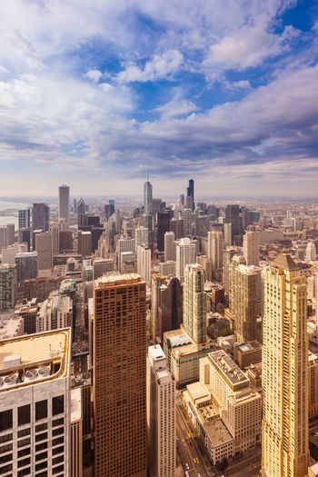 Aerial view of the skyline of downtown Chicago, Illinois, USA American Chicago Downtown Illinois Magnificent Mile Panoramic Skyline Skyscrapers USA Aerial View America Apartment Architecture Building City Cityscape Crowd High Angle View Office Buildings Skyscraper Sunset Tall - High The Loop Tower