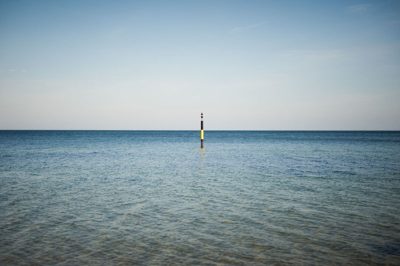 Water Sea Sky Horizon Over Water Horizon Scenics - Nature Beauty In Nature Waterfront Tranquil Scene Tranquility Nature Clear Sky No People Day Outdoors Guidance Idyllic Non-urban Scene Remote Wooden Post Graphic My Best Photo