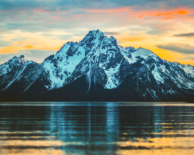 Grand Teton National Park  Wyoming Beauty In Nature Cloud - Sky Cold Temperature Ice Idyllic Lake Mountain Mountain Peak Mountain Range No People Reflection Scenics - Nature Sky Snow Snowcapped Mountain Sunset Tranquil Scene Tranquility Water Waterfront Winter The Traveler - 2018 EyeEm Awards