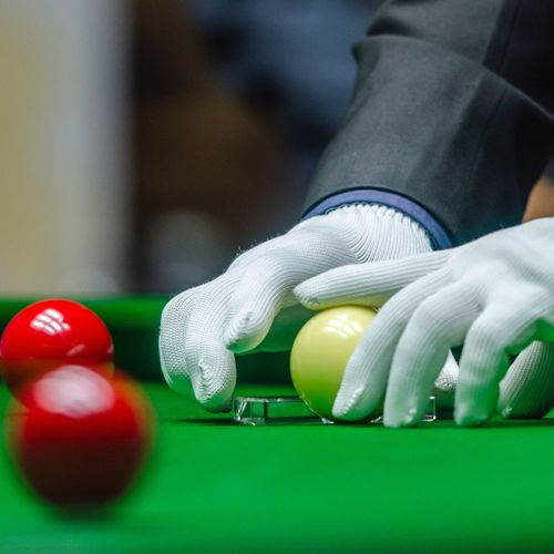 Cropped hands placing balls on pool table