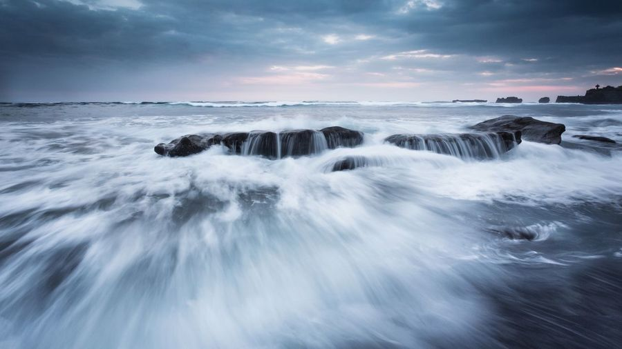 Mengening Beach, Bali, Indonesia Waves Bali Mengening Beach Sea Water Motion Sky Beauty In Nature Cloud - Sky Scenics - Nature Outdoors Rock Environment Horizon Over Water Blurred Motion Long Exposure Rock - Object Beach Sport Wave Nature Land Horizon