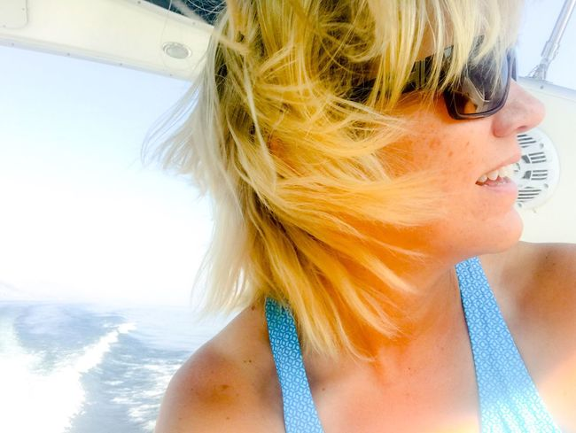 Blond Hair Real People One Person Leisure Activity Lifestyles Day Sea Transportation Vacations Outdoors Close-up Sky Young Adult Mix Yourself A Good Time The Week On EyeEm Horizon Over Water Floating In Water Blue Background Water Young Women Boating Life Windy Hair Wind And Sun