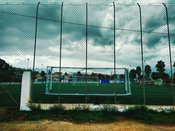 Sunday mornings Snapseed Mobile Photography Football Field Overcast Cloudscape Empty Places No People Enclosure Mesh, Nets, Collection, Material, Textile, Fabric, Mesh Wire Fence All Is Loneliness Large Group Of People Team Sport Day Real People Sky Playing Field Soccer Field