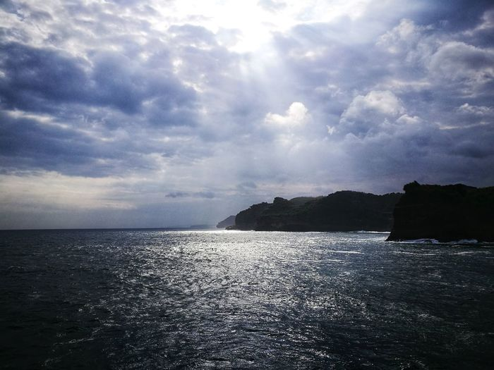 See the light as it shines on the sea Water Sea Nature Horizon Over Water Cloud - Sky No People Scenics Beach Outdoors Beauty In Nature Day Sky INDONESIA Indonesia_photography Pantai Timang Lost In The Landscape