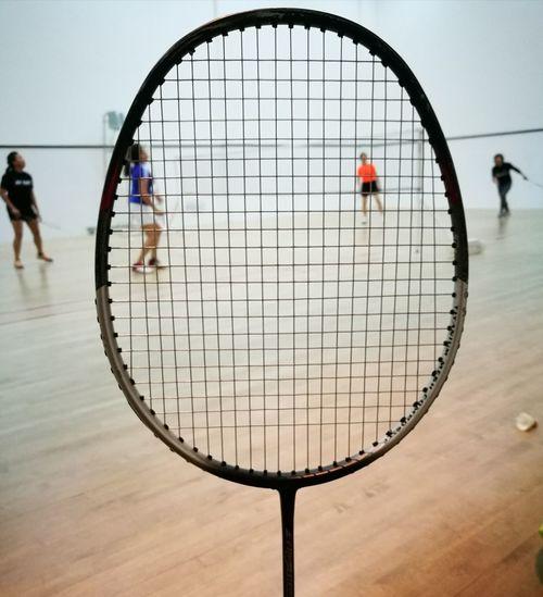 People seen through badminton racket