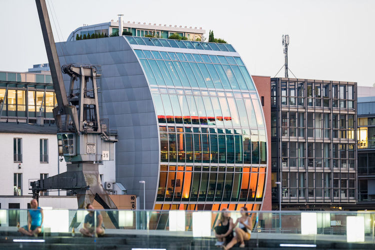 DUESSELDORF, GERMANY - SEPTEMBER 14, 2016: The new media harbor is a scenic place to be and combines modern architecture with traditional elements Architecture Attraction Düsseldorf Germany M Medienhafen New Media Harbor People Place To Be  Scenics Ship Tourism Urban Urban Geometry Water
