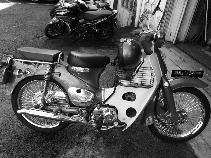 Old motorcycle, got fresh equipment. Old-fashioned Honda C70 P9leica Retro