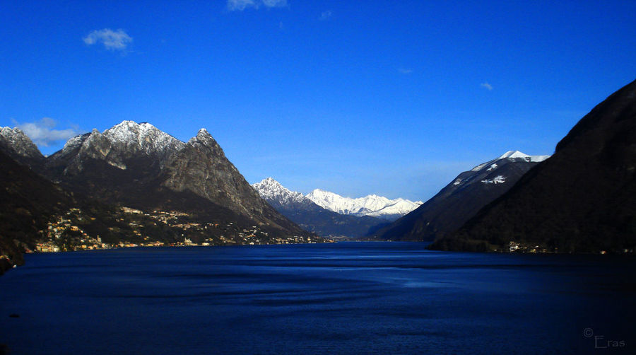 Scenic View Of Lake Lugano By Mountain Against Sky