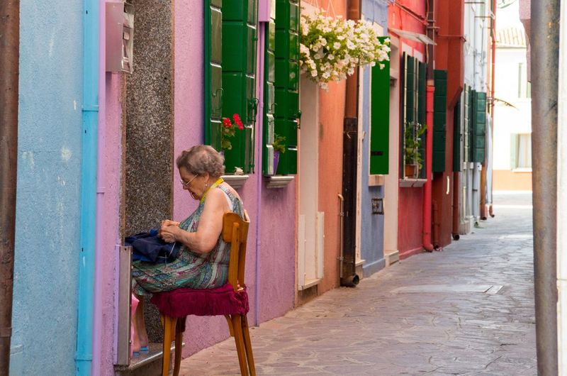 Adult Architecture Building Exterior Burano Chair Colourful Day Flower Full Length Italy One Person One Woman Only Only Women Outdoors Painted Houses People Sewing Sitting Travel Venice Venice, Italy