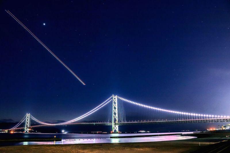 Illuminated suspension bridge at night