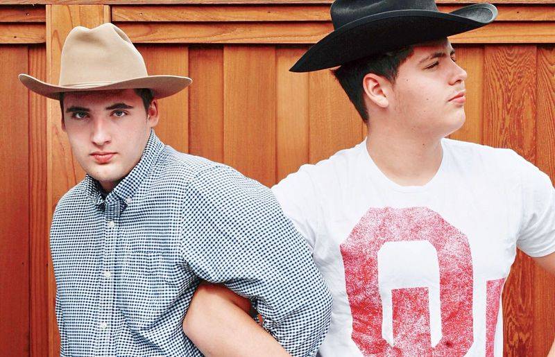 Arms Intertwined American South Brothers Cowboy Hat Vintage Hats Teenagers  Cowboy Hats  EyeEm Selects Hat Two People Clothing Men Portrait Young Men Young Adult Togetherness Looking At Camera People Fashion Cowboy Males  Lifestyles