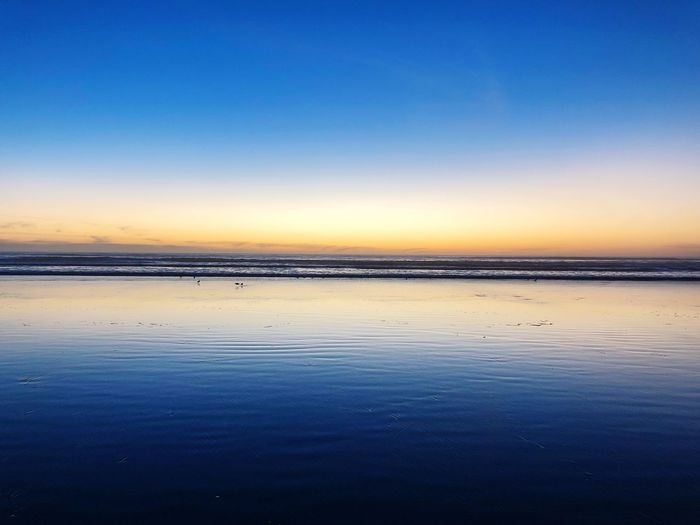 Sky Water Scenics - Nature Tranquility Beauty In Nature Sea Tranquil Scene Clear Sky Copy Space Blue Reflection Non-urban Scene Sunset Land Nature Beach Idyllic Waterfront No People Horizon Over Water