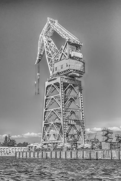 Dock tower crane in the quay of Sevastopol bay, Crimea Architecture Building Exterior Built Structure Cloud - Sky Day Land Low Angle View Metal Nature No People Outdoors Sea Sky Tall - High Tower Travel Travel Destinations Water Waterfront