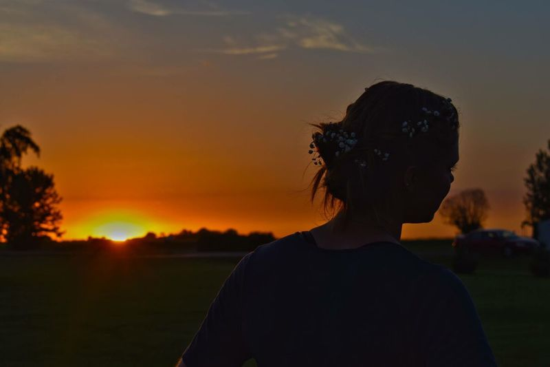 Portrait of silhouette man standing on field against sky during sunset