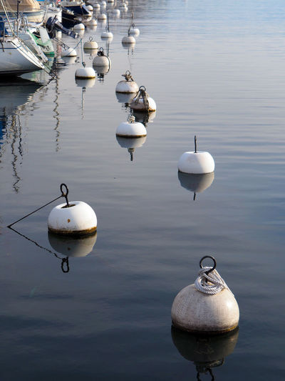 Boat Boats Buoy Buoys Lake Lakeside Nautic Nautical Naval No People Old Buoys Reflection Rope Ropes Rust Rusty Sea Sea Buoy Seaside Water Water Reflections Water_collection