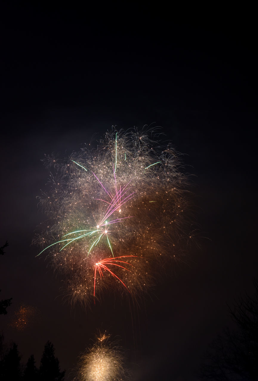 LOW ANGLE VIEW OF FIREWORKS EXPLODING IN SKY