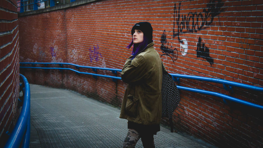 Full Length Real People Brick Wall Young Women Young Adult Outdoors Lifestyles City Multi Colored Alternative EyeEmNewHere Portrait Of A Woman Redandblue Perspectives On People