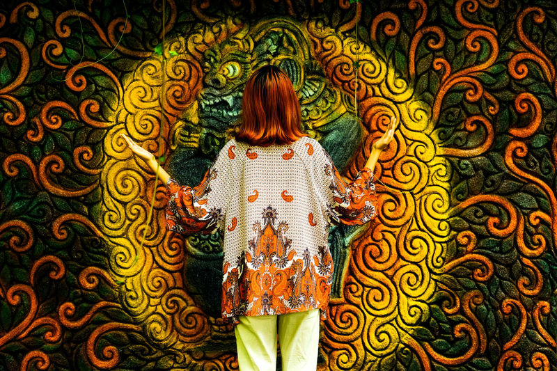 The Portraitist - 2018 EyeEm Awards Adult Fashion Floral Pattern Hair Leisure Activity Lifestyles One Person Pattern Real People Rear View Redhead Three Quarter Length Young Adult Young Women