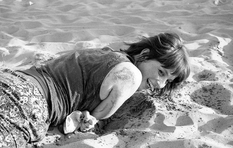 Joyful moments. Mix Yourself A Good Time The Week On EyeEm EyeEmNewHere Beautiful Woman Beach Black & White Photography Analogue Photograhy 35mm Film Photography Real People Filmisalive Filmsnotdead BW_photography Portraits Humans Filmphoto Joy Enjoying Life Sun Sand Sand And Sea One Person EyeEm Gallery Walking Around Outdoors Noir Et Blanc Black And White Friday Inner Power Focus On The Story Moments Of Happiness International Women's Day 2019 The Art Of Street Photography My Best Photo