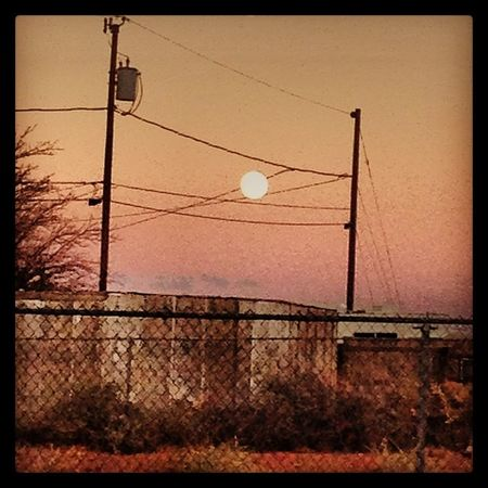 Moon Fullmoon Holbrook Holbrookaz holbrookarizona smalltown sunset lightpoles fence electricpoles poles shack desert evening pretty scenery outdoors sky weather clearsky az arizona
