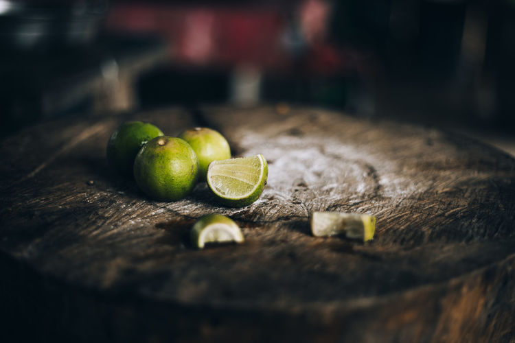 Fruit Food Food And Drink Healthy Eating Freshness Wellbeing Citrus Fruit Still Life Green Color No People Indoors  Lemon Close-up Wood - Material Lime Table SLICE Selective Focus Vegetable Lemonade Lemon Tree Cooking Cute Cut Kitchen