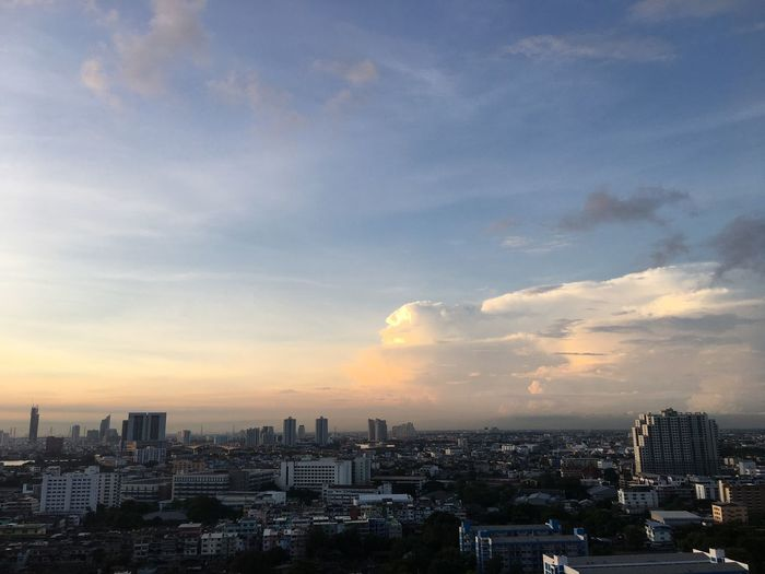 Morning light #Sunrise #Bangkok #Thailand #EyeEmSelects #Nature  #cloud #sky #sun Building Exterior Architecture City Cityscape Built Structure Sky Building Cloud - Sky Nature City Life Landscape Outdoors No People Residential District