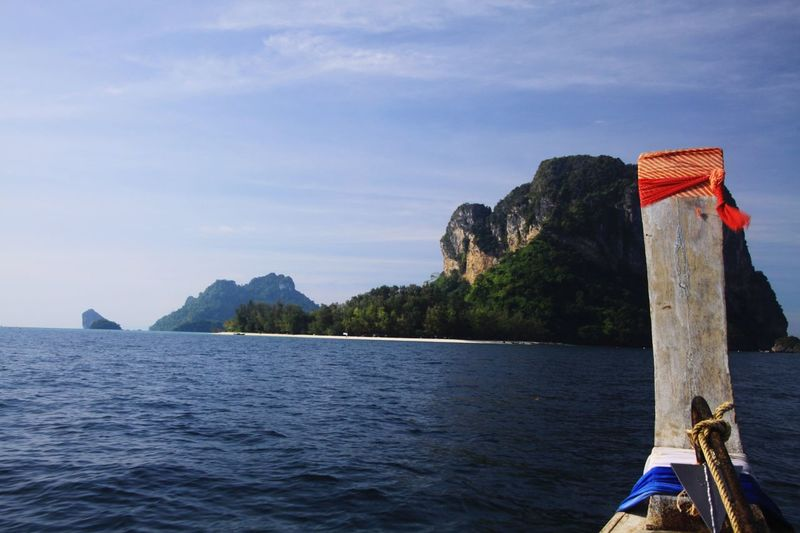 Boat Trip near Ao Nang Sea Water Nature Sky Blue Day Outdoors Boat Thailand Tranquility Island Transportation Mountain Land Beauty In Nature No People Longtail Boat Railay Ao Nang Tranquil Scene Nautical Vessel Mode Of Transportation Scenics - Nature Waterfront Wooden Post
