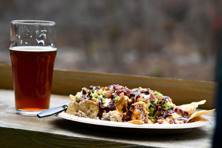 Close-up of food and beer on table