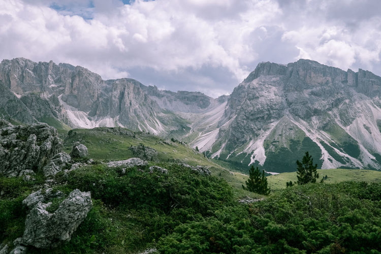 Hiking adventures in the Dolomites, Italy. Amazing View Dolomites Hiking Beauty In Nature Bolzano Cliffside Cloud - Sky Day Environment Greenery Hiking Trail Italy Landscape Mountain Mountain Range Nature Peaceful Scenic View Scenics - Nature Sky Top Of The Mountains
