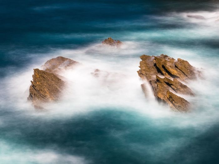 Long exposure of rocks in the surge Nature Beauty In Nature Scenics Rock - Object Tranquility Long Exposure Outdoors No People Water Sky Tranquil Scene Day Landscape Surge Ocean Waterfront Portugal Peniche Baleal Cliff Rocky