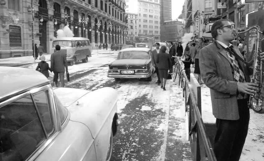 Architecture Blackandwhite City City Life Classic Cars Lotería De Navidad  Old Cars Old Coach House Old Scene Saxo Man Saxophonist Snow City Streetphotography People And Places TakeoverMusic